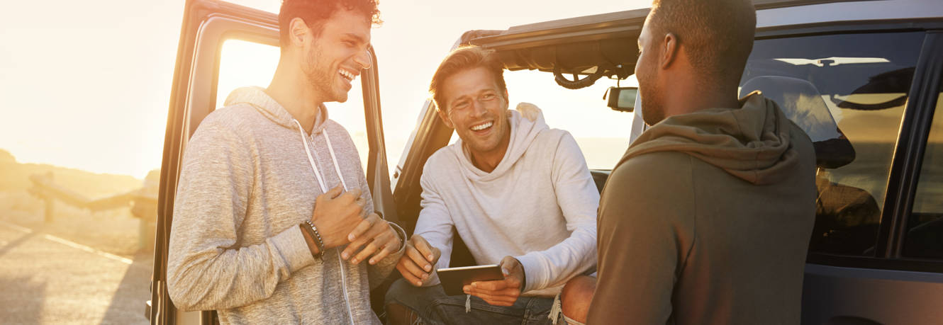 Three friends take a break on their adventurous road trip.