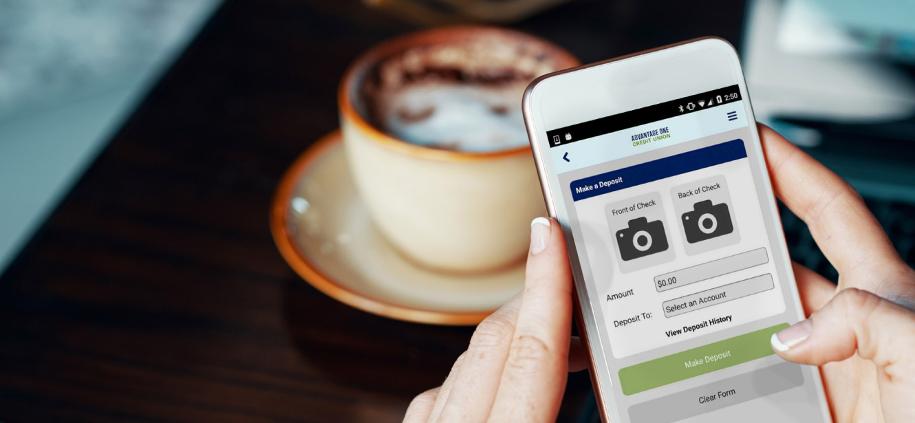A woman is using the Advantage One Credit Union mobile banking app while enjoying a cup of coffee.